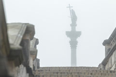 Famous Sigismund's Column silhouette in fog view from stone stairs in Polish Warsaw Stock Photos