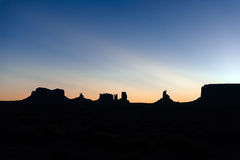 Famous silhouette of sandstone in monument valley, sunrise Royalty Free Stock Photography