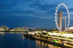 The famous Singapore Flyer Ferris wheel in front of Marina Bay at night stock images