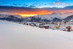 Famous ski resort in the Alps,Les Sybelles,France. Fantastic sunrise,winter landscape and ski resort in French Alps,La Toussuire,France,Europe Royalty Free Stock Photography
