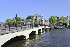 Famous 'Skinny Bridge' in Amsterdam canal belt. AMSTERDAM-AUG. 19, 2012. Drawbridge on Aug. 19, 2012 in Amsterdam. It is known as Venice of the North. The city Stock Photos