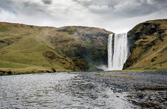 Famous Skogafoss waterfall in Iceland at dusk stock photography