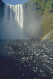Famous Skogafoss waterfall located in Iceland with rainbow Stock Image