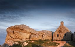 Famous small watch house coastline in Meneham,  Brittany.  Royalty Free Stock Images