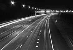 The famous Snelweg motorway in the Netherlands. At nighttime withstreaks of light from cars in time lapse exposure Stock Images