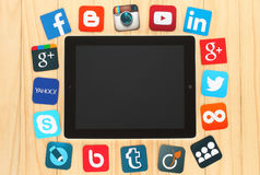 Famous social media icons placed around iPad. KIEV, UKRAINE - JULY 01, 2015: Famous social media icons such as: Facebook, Twitter, Blogger, Linkedin, Google Plus stock illustration
