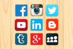 Famous social media icons placed on wooden background. KIEV, UKRAINE - JULY 01, 2015: Famous social media icons such as: Facebook, Twitter, Blogger, Linkedin royalty free illustration