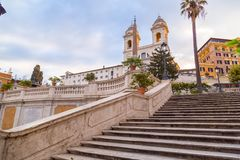 Spanish Steps at Piazza di Spagna and Trinita dei Monti church. The famous Spanish Steps at Piazza di Spagna and Trinita dei Monti church at the top in Rome stock image