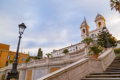 Spanish Steps at Piazza di Spagna and Trinita dei Monti church. The famous Spanish Steps at Piazza di Spagna and Trinita dei Monti church at the top in Rome stock images