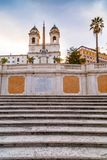 Spanish Steps at Piazza di Spagna and Trinita dei Monti church. The famous Spanish Steps at Piazza di Spagna and Trinita dei Monti church at the top in Rome royalty free stock image