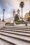 Spanish Steps at Piazza di Spagna and Trinita dei Monti church. The famous Spanish Steps at Piazza di Spagna and Trinita dei Monti church at the top in Rome royalty free stock photo