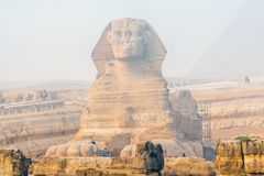 Famous Sphinx and the Great pyramids. In fog and smog, Giza, Cairo, Egypt royalty free stock images