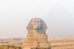 Great pyramids. Famous Sphinx and the great pyramids in fog and smog, Giza, Cairo, Egypt royalty free stock photography