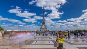 Famous square Trocadero with Eiffel tower in the background timelapse hyperlapse. Trocadero and Eiffel tower are the most visited attractions of Paris. Blue stock video footage