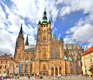 The famous St. Vitus Cathedral in the Prague Castle. In Prague in the Czech Republic on a beautiful sunny day with light clouds at a brightly blue sky Royalty Free Stock Photo