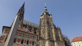 Famous St Vitus Cathedral in Prague castle in sunny day, monument of neo-gothic style. Famous St Vitus Cathedral in Prague castle in sunny day, monument of neo stock video footage