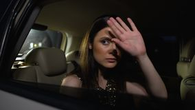 Famous star sitting in car, hiding with hand from public, another side of glory. Stock footage stock footage