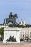 Famous Statue and Fourviere basilica on a background in Lyon cit Royalty Free Stock Photo