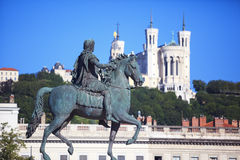 Famous statue of Louis XIV and Basilique of Notre Dame de Fourvi Stock Photo
