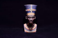 Famous Statuette Bust of Queen Nefertiti. Isolated on Black Background Royalty Free Stock Photography