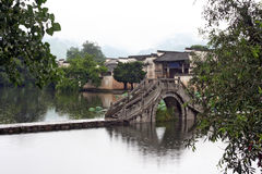 Famous stone bridge leading to ancient Hongcun village in Anhui Stock Photo