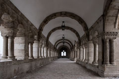 Famous stone tunnel and tourist walkway in Buda castle stock image