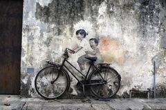 Free Famous Street Art And Graffiti Paintings Of Children On A Bicycle Along Armenian Street, Penang, Malaysia Stock Images - 106849724