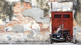 Famous Street Art Mural in George Town, Penang, Malaysia royalty free stock photo