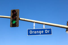 Famous street sign orange drive with green traffic light Stock Photo