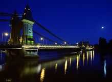 The half moon over spanned bridge at night. Famous structure in mid wee hours, with the crescent moon in view Royalty Free Stock Images