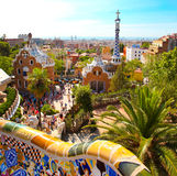 The Famous Summer Park Guell in Barcelona. The Famous Summer Park Guell over bright blue sky in Barcelona, Spain Stock Photo
