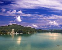 The Famous Sun Moon Lake. A view of the beautiful Sun Moon Lake in Taiwan with the Central Mountains in the back stock photo