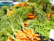 Famous Sunday Hollywood Farmers Market Vegetable Stand. Selling beautiful carrots and green beans direct from a local farmer in Southern California Stock Photo