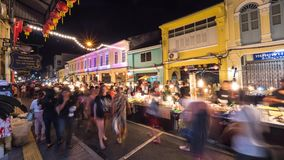 Famous Sunday Night Market in Phuket Town. Tourists Walking and Shopping at Old Street full of Local Vendors Selling