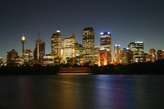 Famous Sydney architectures. In lights reflected on sea surface. Drag effect. Sydney. Australia Stock Photos