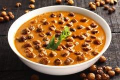 Famous Tamilnadu curry dish Vatha kulambu. Overhead view-Famous Tamilnadu curry dish Vatha kulambu Royalty Free Stock Image
