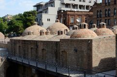 Famous Tbilisi landmark - medieval sulphur bathes,Georgia. Famous Tbilisi landmark - medieval sulphur bathes in Abanotubani district,Meidan square,historical Royalty Free Stock Image