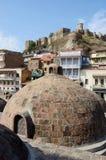 Famous Tbilisi landmarks - medieval sulphur bathes,Georgia. Famous Tbilisi landmarks - medieval sulphur bathes in Abanotubani,Meidan square,and Narikala fortress Royalty Free Stock Photos