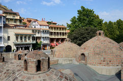 Famous Tbilisi landmarks - medieval sulphur bathes,traditional georgian houses Royalty Free Stock Image