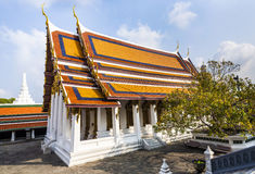 Famous temple Phra Sri Ratana Chedi covered with foil gold in th Royalty Free Stock Images