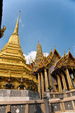 Famous temple Phra Sri Ratana Chedi covered with foil gold in th Royalty Free Stock Image