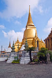 Famous temple Phra Sri Ratana Chedi covered with foil gold in th Stock Photos