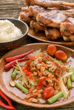 Famous Thai food, papaya salad and grilled chicken Royalty Free Stock Images