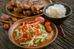 Famous Thai food, papaya salad and grilled chicken Stock Photography