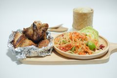 Famous Thai food papaya salad and grilled chicken Stock Image