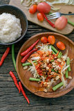 Famous Thai food, papaya salad ,somtum. Green papaya salad Thai cuisine spicy delicious with sticky rice on wooden plate , SomTam royalty free stock image