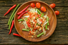 Famous Thai food, papaya salad ,somtum. Green papaya salad Thai cuisine spicy delicious on wooden plate , SomTam royalty free stock photo