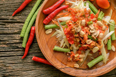 Famous Thai food, papaya salad ,somtum. Green papaya salad Thai cuisine spicy delicious on wooden plate , SomTam stock images