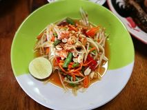 Famous Thai food, papaya salad or what we called `Somtum` in Thai. Papaya salad. Traditional spicy Thai food. Famous Thai food, papaya salad or what we called ` royalty free stock photos