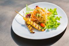 Famous Thai papaya salad or  Somtum with Chicken satay on side.  Stock Photos
